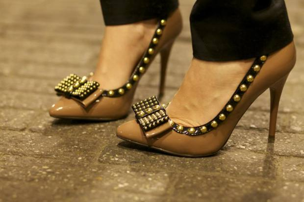 The look got a feminine touch with these killer heels.
